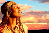 image of facial piercings  - Beautiful African American woman in sunset with mountains in the background - JPG