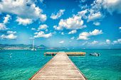 Pier In Turquoise Sea And Blue Sky With White Clouds In Philipsburg, Sint Maarten. Freedom, Perspect poster