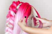 The Hairdresser Weaves Braids With Pink Kanekalons Beautiful Blonde Beauty Salon. poster
