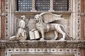 sculpture at the Porta della Carta of the Doges Palace, venice: The doge kneeling in front of Saint