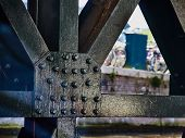Bridge Construction On Rivets Above The Canal poster