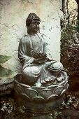 Buddhist Statue Sitting In Meditation Outside In Nature poster