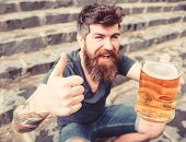 Man With Beard And Mustache Holds Glass With Beer And Shows Thumb Up, Stone Stairs Background. Draug poster