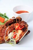 foto of ayam  - Javanese fried chicken named ayam kalasan focus on raw vegetables - JPG