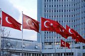 National flags of Republic of Turkey waving in front of the Ministry of Foreign Affairs Building poster