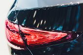 Back View Of New Black Car. Closeup Headlights Of Car. Black Premium City Crossover, Luxury Suv Rear poster