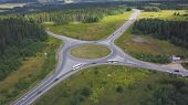 Top View Of Rural Roundabout With Traffic. Clip. Beautiful Landscape Of Forest Horizon And Rural Int poster