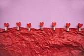 Clothespins With Hearts Hang On A Rope On A Colored Background. Festive Concept In Minimal Style For poster