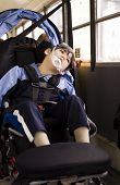 image of physically handicapped  - Disabled little boy sitting in wheelchair on school bus - JPG