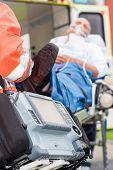 picture of defibrillator  - Emergency defibrillator patient with oxygen mask on ambulance stretcher - JPG