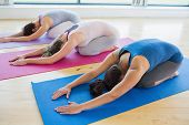 picture of spare  - Women doing childs pose in yoga class in fitness studio - JPG