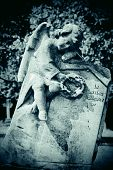 image of cherub  - Cherub on grave stone with blank space - JPG