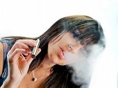 image of substitutes  - brunette beautiful girl smoking a electronic cigarette - JPG