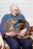 Elderly Man With Animal