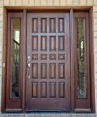 stock photo of front door  - Large Wooden Front Door of an Expensive Home - JPG