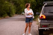pic of flashers  - Lady waiting a car servise on the roadside - JPG