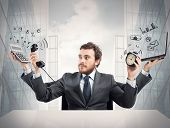 image of fatigue  - Concept of busy multitasking businessman at work - JPG