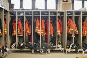 stock photo of medevac  - Fire fighter suits at the fire station - JPG