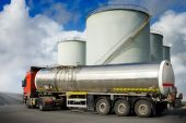 pic of tank truck  - Truck and fuel tanks at the background and blue sky - JPG