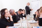 stock photo of boredom  - Photo Of Sad Business Team Attending The Seminar - JPG