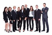 stock photo of lineup  - Lineup of diverse professional business executives or partners standing relaxed in a row isolated on white - JPG