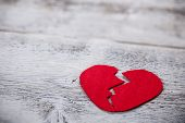 picture of breakup  - Felt heart on a white wooden background - JPG