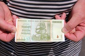 picture of billion  - Caucasian Man with a twenty billion Zimbabwe Dollars Banknote - JPG