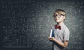 picture of formulas  - Genius boy in red glasses near blackboard with formulas - JPG