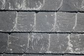 foto of tile cladding  - Many slate tiles are used as exterior cladding of a residential building - JPG