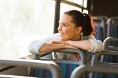 picture of commutator  - pretty female commuter daydreaming on bus - JPG
