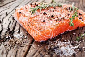 picture of carving  - Salmon filet with spices on a wooden carving board - JPG