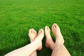 stock photo of barefoot  - Couple Relax barefoot enjoy nature in the green lawn - JPG