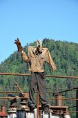 foto of breather  - Funny figure like a stalker with mountain background - JPG
