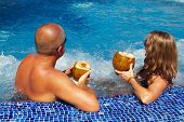 pic of hot-tub  - Couple with coconut drink relaxing in hot tub - JPG