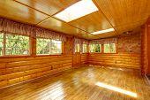 image of log cabin  - Bright empty log cabin house interior with hardwood floor skylights and windows - JPG