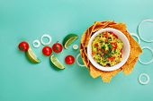 stock photo of dipping  - Ingredients for guacamole and guacamole dip. top view ** Note: Shallow depth of field - JPG
