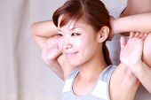 image of chiropractic  - portrait of young Japanese woman getting chiropractic - JPG