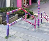 stock photo of bannister  - urban knitting is a type of street art also known as yarn bombing - JPG