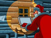 picture of letters to santa claus  - cartoon Santa Claus typing a letter on the computer - JPG