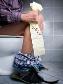 stock photo of defecate  - Conceptual view of digestive problems like constipation or diarrhea - JPG