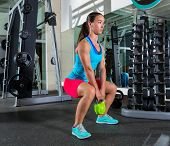 foto of squatting  - goblet kettlebell squat woman workout exercise at gym - JPG