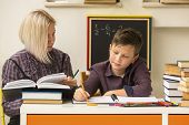 pic of tutor  - Elementary school student doing homework with a tutor - JPG