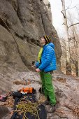 stock photo of mountain-climber  - The young man in the mountains insures climber - JPG