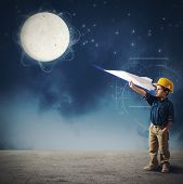 foto of spaceman  - Child imagines launch a shuttle to moon - JPG