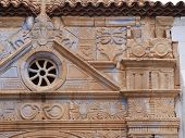 image of panther  - The church of Nuestra Senora de Regla in Pajara in Spain has interesting sculptures of sun pattern snakes panther and birds above the main entrance - JPG