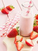 stock photo of milk glass  - Vintage glass bottle with milk and fresh strawberries - JPG