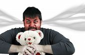image of strangling  - Man strangling teddy bear anger management frustration or head exploding concept - JPG