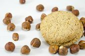 image of hazelnut  - Integral biscuits on white table surrounded by hazelnuts - JPG