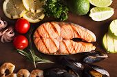 stock photo of salmon steak  - Grilled salmon steak with vegetables and seafood - JPG
