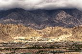 stock photo of jammu kashmir  - Rocky landscape of Leh City with Himalayan mountains in background Ladakh Jammu and Kashmir India - JPG